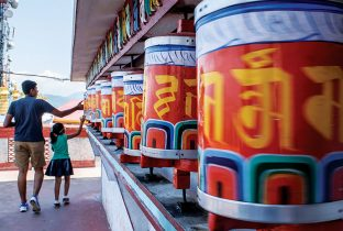 Prayer wheels, at selective focus, at Zang Dhok Palri Phodang, a Buddhist monastery in Kalimpong in West Bengal, India shutterstock_633820679 770x508pxl-Recovered