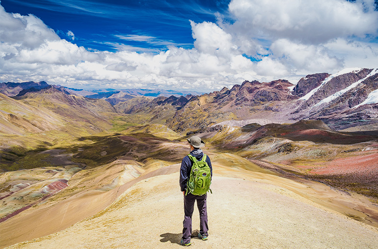 Standing on the top of Rainbow Mountain. Peru South America South American Travel Specialists