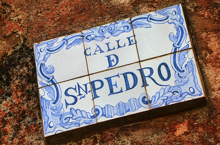 Street sign on a stone wall in Colonia del Sacramento, Uruguay. It is one of the oldest towns in Uruguay